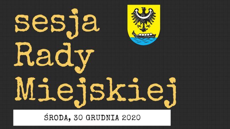 sesja rady miejskiej. czarne tło, żółte litery, herba miasta
