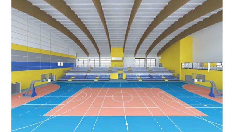 wizualizacja hali widowiskowo sportowej. na głównym planie zarys pola do gry, w oddali siedzenia dla widowni, za nimi okna